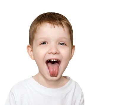 little boy sticking out his tongue photo