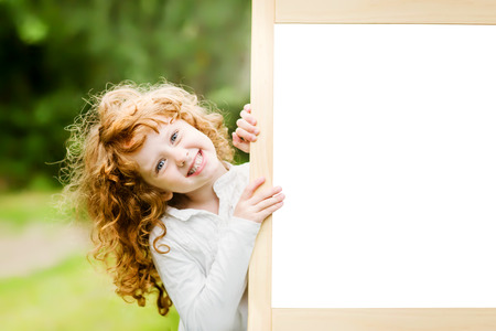 Smiling girl near a white board. Educational and medical concepts.