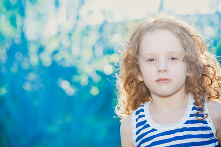 Curly child in a suit a sailor.  Adventure  concept. Stock Photo