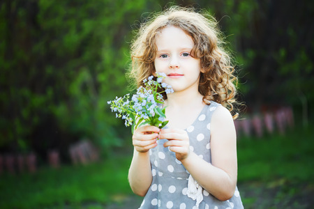 Happy girl with a flower in her hand. Mothers day concept.