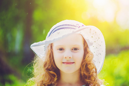 sunstroke: Little girl wearing a hat for protection from sunstroke.