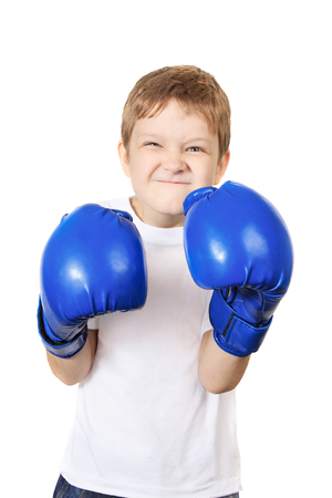 boy boxing: Boy in blue boxing gloves, isolated on white background. Healthy lifestyle concept. Stock Photo