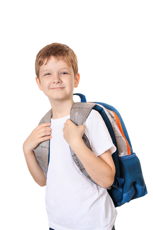 school children: Schoolboy with bag isolated on white background.