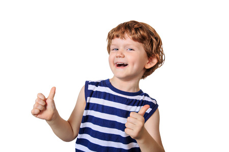 child laughing: Laughing child showing thumbs up. Photo isolated in white. Stock Photo