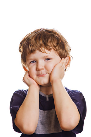the cheeks: A little boy holding his hands over his cheeks. Surprised or scared. Photo isolated in white.