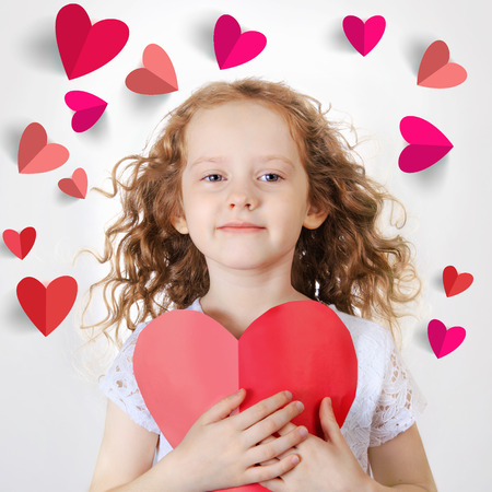 sweet heart: Sweet girl holding red paper heart. Valentines day or healthcare, medical concept.