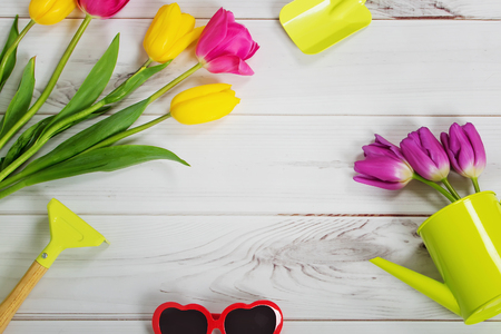 Easter background. Coloring spring tulips on light wooden table. Toning instagram filter. Stock Photo