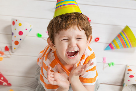 Screaming child in bithday party, cute boy crying.