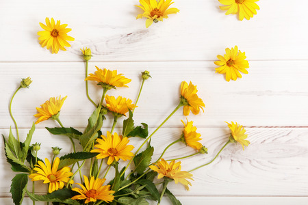 vitality: Bouquet yellow daisy flowers on wooden table. High top view.