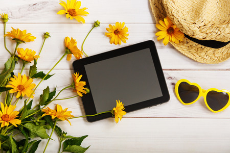 patern: Summer patern with yellow daisies, straw hat, tablet and glasses in the shape of a heart. Stock Photo