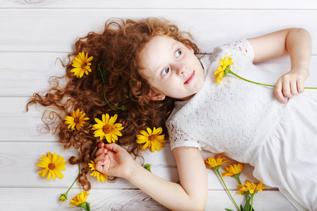 inulin: Surprised girl with bouquet of yellow flowers. Mothers day concept, holiday concept. Stock Photo