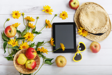 inulin: Summer pattern with yellow flowers,  red apples, straw hat, tablet pc and glasses in the shape of a heart.