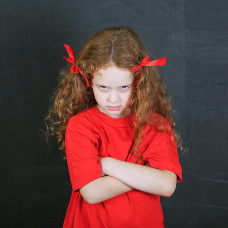 unruly: Emotional child with angry expression on face. Child character. Health and medical concept.