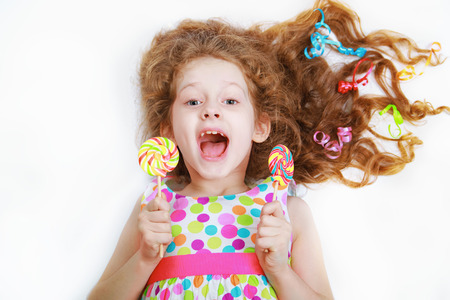 Surprised funny girl  hold candy lollipop. Healthy lifestyle concept. Stock Photo