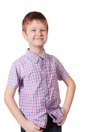Happy little boy in a checkered shirt isolated in white background.