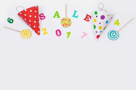 Greeting card for carnival party. Party hat, sweet lollipop, colored numbers on light  background.