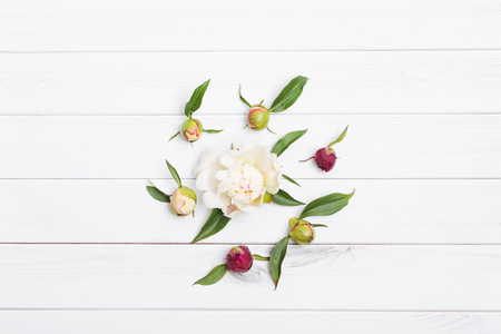 Spring flowers composition for postcard. White peony on wooden background.