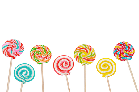 Rainbow candy lollipop on stick isolated in white.