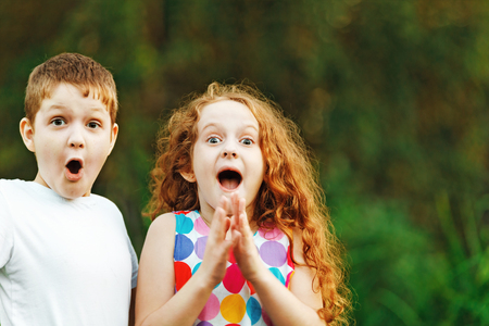 Surprised little children smile and happy in summer outdoor.
