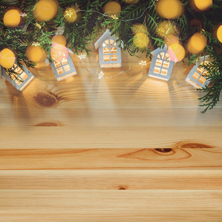 Christmas background with small houses and starry garlands.