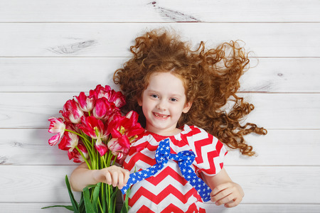 Little girl with bouquet of tulips. Mothers day concept, holiday concept.