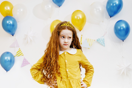 Little curly girl with upset expression on face. Archivio Fotografico