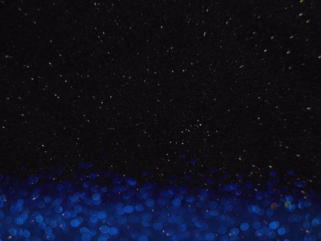 Star sky and blue bokeh background, abstract with defocused lights. 写真素材