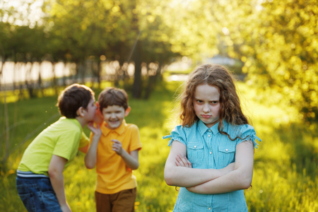 Little girl offended after quarrel to his brothers. Imagens - 108470765