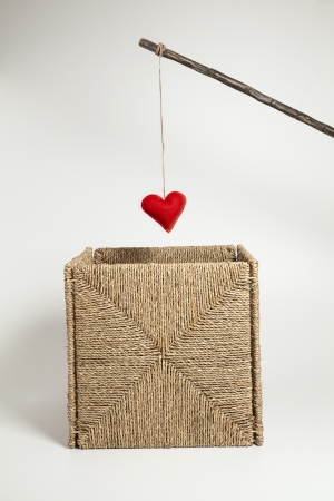 Hooking a heart rom a wicker box  photo