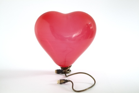connexion: A red balloon with a USB connexion Stock Photo