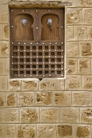 influenced: Arabic influenced architectonical detail of a timbuktu wodden window Stock Photo
