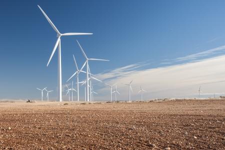 rural development: Windmill s landscape with a reddish land