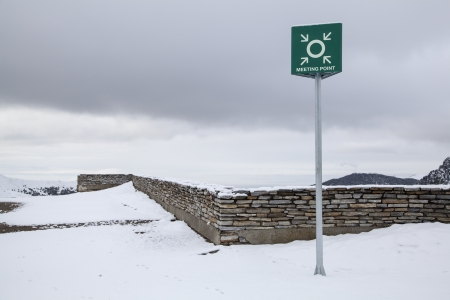 wheater: Meeting point sign at a snowy winter landscape