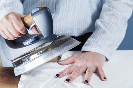 Steam iron: Iron burn on hand, a common domestic accident     Stock Photo