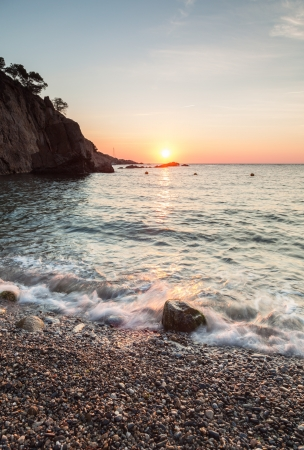 Sunrise in cala Pedrosa photo