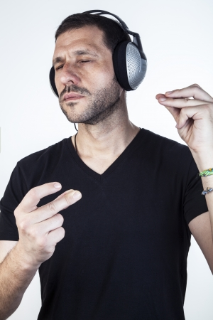 Middle age man vibrating with music photo