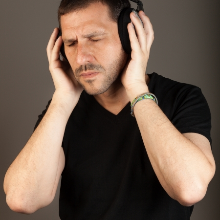 vibrating: middle age man vibrating with music