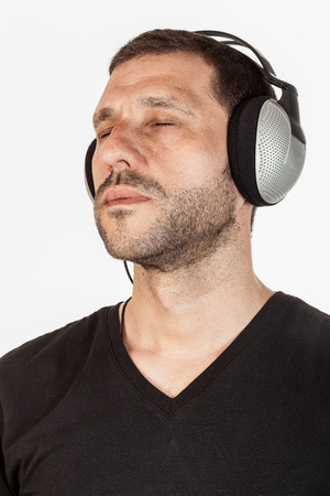 age 30 35 years: Middle age man with closed eyes, listening to music