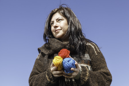 25 35: Young knitter with coloured yarns of wool in her hands
