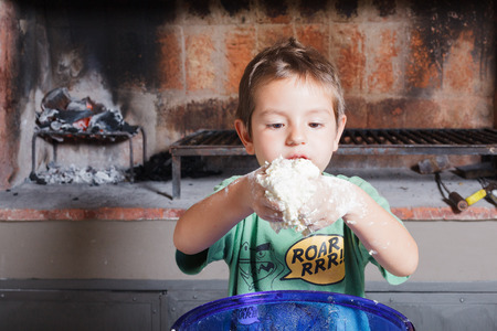 Boy kid cooking in kitchen photo