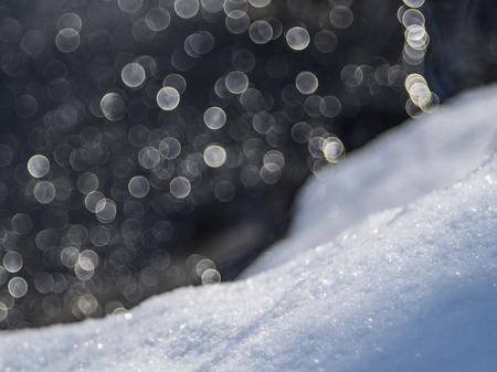 Bubbles sinking down on snow Фото со стока