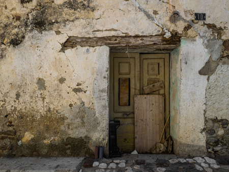 old door with decayed wall in italy