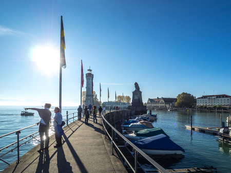 people enjoing a sunny day at Lindau harbour Editorial