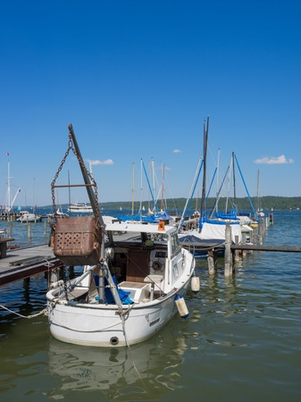 boats tied to a pier, starnberger see, germany Stock Photo
