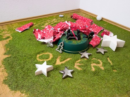 Floor covered with fir needles and decoration with the word over