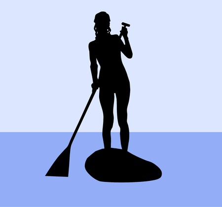 Silhouette of a female standup paddler