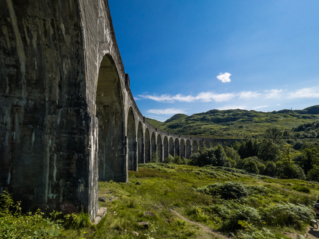 Genfinnan Viaduct on a sunny day with blue sky
