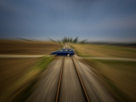 Train perspective of a car passing a railroad crossing with strong motion blur