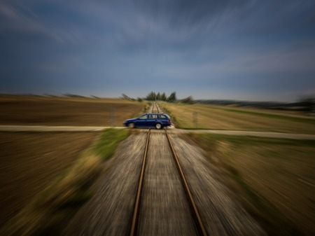 Train perspective of a car passing a railroad crossing with medium motion blur Imagens