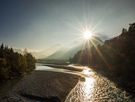 Sunset in the Lech valley, Austria seen from a suspension bridge